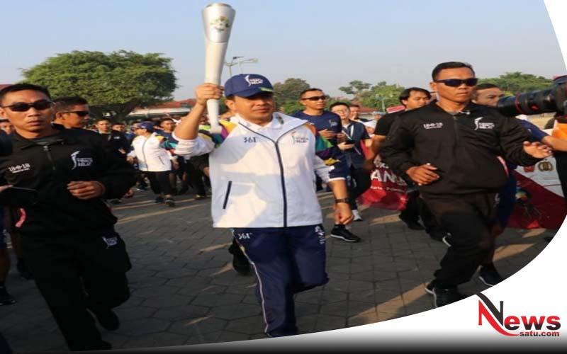 Kapolda DIY Berlari Membawa Api Obor Asian Games 2018