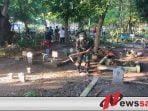 Sambut Kedatangan Bulan Ramadhan, Kodim Surabaya Bersih-bersih Makam