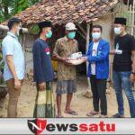 Polres Gandeng PMII Pamekasan Bagikan Bansos dan Masker Kepada Warga Kurang Mampu